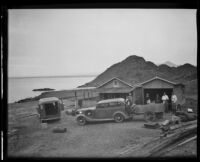 Ralph B Seeley, Frank Seebold, Mildred Fletcher, Ed Fletcher, Louise Whitney, and Stephen Fletcher stand outside their lodging during their fishing trip at the Gulf of California, Mexico, 1935