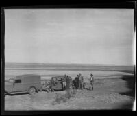 Ralph B Seeley, Frank Seebold, Mildred Fletcher, Ed Fletcher, Louise Whitney, and Stephen Fletcher take a break to enjoy the costal view, Gulf of California, Mexico, 1935