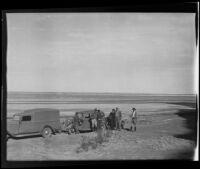 Ralph B Seeley, Frank Seebold, Mildred Fletcher, Ed Fletcher, Louise Whitney, and Stephen Fletcher take a break to enjoy the costal view, Gulf of California, Mexico, 1935