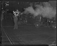 Detective Lieutenant George Hill shoots tear gas toward Los Angeles Railway strikers, Los Angeles, 1934