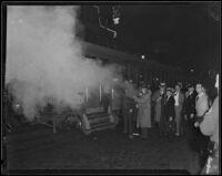 Detective Lieutenant Jack A. Stambler uses tear gas against Los Angeles Railway strikers, Los Angeles, 1934