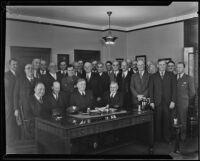 Samuel Moody Haskins, P. B. Harris, and officials discuss railway strike negotiations, Los Angeles, 1934