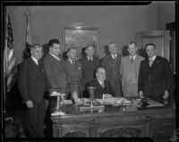 P. B. Harris, J. Stuart Neary, Richard Sasche, Samuel M. Haskins, Patrick Joseph O'Brien, R. B. Armstrong, A. W. Hoch and Mayor Frank Shaw gather to discuss the railway strike, Los Angeles, 1934