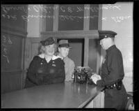 Officer Eugene C. Mullenaux with Vera Shuvalova and Stan Laurel before Vera serves her jail sentence, Beverly Hills, 1939