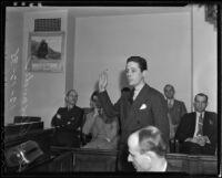Ross Alexander raises his hand in testimony, Los Angeles, 1935
