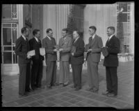 William G. Dickinson, Fred B. Palmer, H. Gordon Moore, B. W. Tye, John A. Ash, and Edward J. Partridge are presented with awards in real estate by Norman Chandler, Los Angeles, 1936