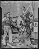 Alfred James Dewey and Millard F. Malin work on Sierra Madre's Rose Parade entry, Pasadena, 1938
