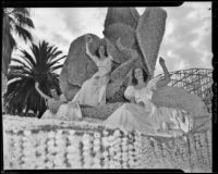 Queen Barbara Dougall rides her float in the Tournament of Roses Parade, Pasadena, 1939