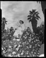 Shirley Temple, Grand Marshall, rides her float on a throne of roses at the Tournament of Roses Parade, Pasadena, 1939