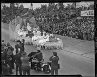 Queen Barbara Dougall and her court at the Tournament of Roses Parade, Pasadena, 1939