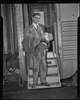 American boxer Lou Nova getting off a train, Los Angeles, 1939