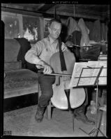 Jack Shadle plays on his cello, Los Angeles, 1938