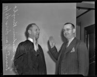 Judge Goodwin J. Knight swears in Everett Sanders as California State Athlete Commissioner, Los Angeles, 1939