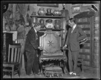 Charles F. Lummis shows the Duke of Alba an antique chair, Los Angeles, 1924