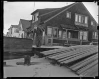 An unidentified man observes the storm damage at Sunset Beach, 1939