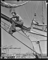 R.L. Yates sits atop a bowsprit, Newport Beach, 1938-1939