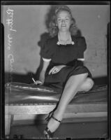 Betty McConnell smiles from a bench, Los Angeles, 1938