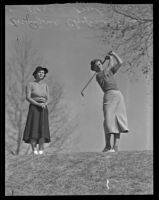 Marjorie Chapman Ferrie and Peggy Graham on the golf course at Griffith Park, Los Angeles,  1938-1939