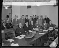 C. W. Burbrow, Frank Karr, Angus D. McDonald, Ray L. Chesebro, Leon O. Whitsell, Clyde L. Seavey, H.R. Brashear, E.E. Bennett, Frederick Von Schrader, A.G. Mott, Joseph G. Hunter, W. H. Gorman, S. V. Meigs, Robert Brennan, Arthur T. George, and Vincent D. Kennedy, gathering to discuss the railroad, Los Angeles, 1933