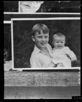 Frank Emerson is held by his older brother Walter Emerson, Los Angeles, 1935