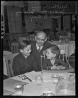 Judge Ben Lindsey at lunch with Baby Le Roy and Walter Emerson, Los Angeles, 1935