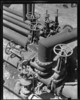 Gas regulator equipment probably created by the Wilgus Manufacturing Company in an oil field, California, circa 1931