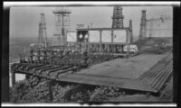 Oil field with gas regulator equipment, probably by the Wilgus Manufacturing Company, California, circa 1931