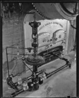 Gas regulator equipment created by the Wilgus Manufacturing Company connected to a Pioneer boiler, Los Angeles, circa 1931