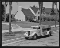 Arrowhead-Puritas spring water delivery truck in a residential neighborhood, Los Angeles County, between 1929-1939