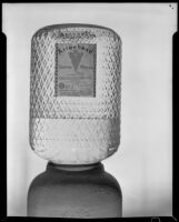 Ornate Arrowhead water cooler bottle embossed with logo arrowheads over the entire surface, Los Angeles, 1935