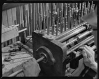Machine in use at a work bench at the F. E. Olds and Son plant, Los Angeles, 1933-1939