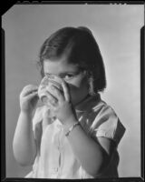 Little girl drinking a cup of Ghirardelli cocoa