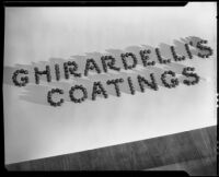 "Advertisement photograph with ""Ghirardelli's Coatings"" spelled with chocolate bon-bons"