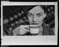 Woman lifting a porcelain cup of hot cocoa in an image created for a Ghirardelli advertisement