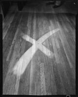 "Wood floor with an ""x""-shaped area cleaned with ""Double X Floor Cleaner,"" circa 1934"