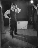 Man standing on a set during a photo shoot to advertise products, 1925-1939