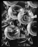 Photomontage composition with repeated images of a man playing a tuba, 1925-1939
