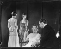 Three women and one man at a photograph session for an advertisement, 1935