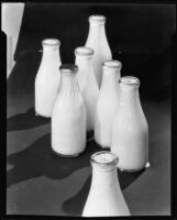 Bottles of Adohr and Hansen brand milk