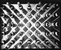 Mission Dry Sparkling carbonated fruit beverage bottles arranged in a grid formation, Los Angeles, circa 1930