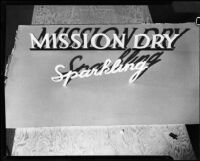 "Logotype for the ""Mission Dry Sparkling"" beverage set up to be photographed, Los Angeles, circa 1930"