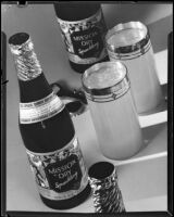 "Two bottles and two full glasses of ""Mission Dry Sparkling"" soda on a table, Los Angeles, circa 1930"