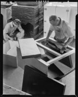 Two men assembling an icebox, 1930-1937