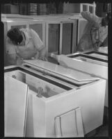 Two men assembling iceboxes, 1930-1937