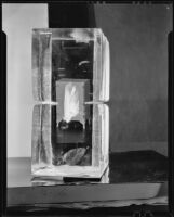 Icebox reflected in two large blocks of ice, 1930-1937