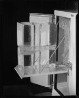 Icebox with blocks of ice on a pull-out shelf, 1930-1937