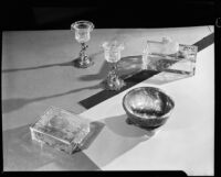 Etched glass objects and stone bowl at the Brock & Company jewelry and gift store, Los Angeles, 1930