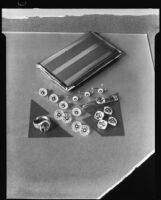 Ring, cuff links, tie clip and cigarette case at the Brock & Company jewelry and gift store, Los Angeles, 1930