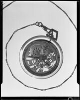 Watch in a glass case at the Brock & Company jewelry and gift store, Los Angeles, 1928-1938