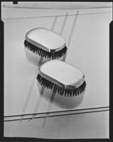 Men's sterling silver hair brushes at the Brock & Company jewelry and gift store, Los Angeles, 1928-1938
